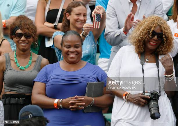 Serena Williams' sisters Venus half sister Isha Price and their mother Oracene Price react as Serena won the 2013 French tennis Open final at the...