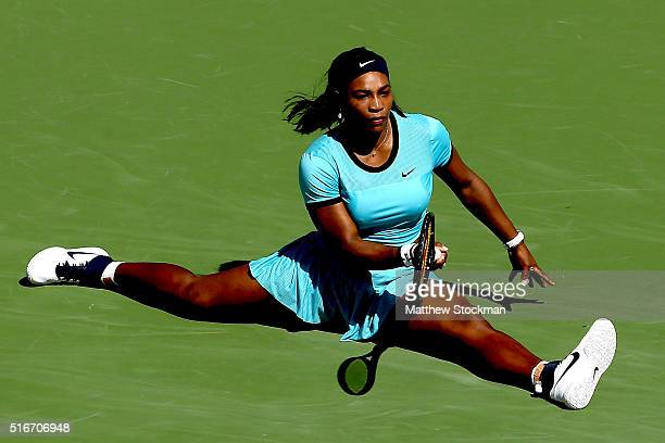 Serena Williams slides to the court after stretching for a shot against Victoria Azarenka of Belarus during the women's final of the BNP Paribas Open...