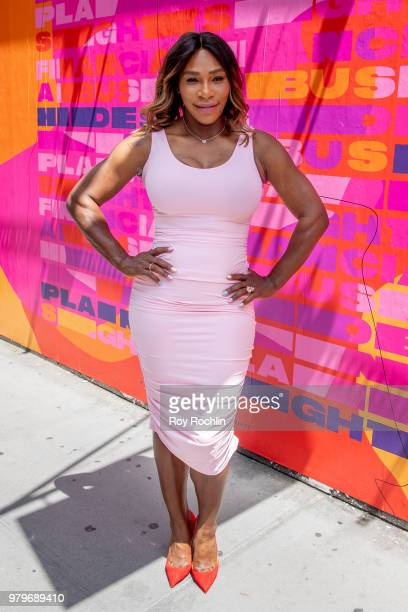Serena Williams stands next to Isabel Castillo Guijarro's mural during the Allstate Foundation Purple Purse and Serena Williams' launch of a national...