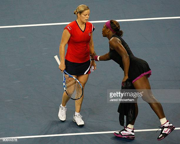 Serena Williams talks to Kim Clijsters of Belgium after Williams was disqualified by a foot fault during the Women's Singles Semifinal match on day...