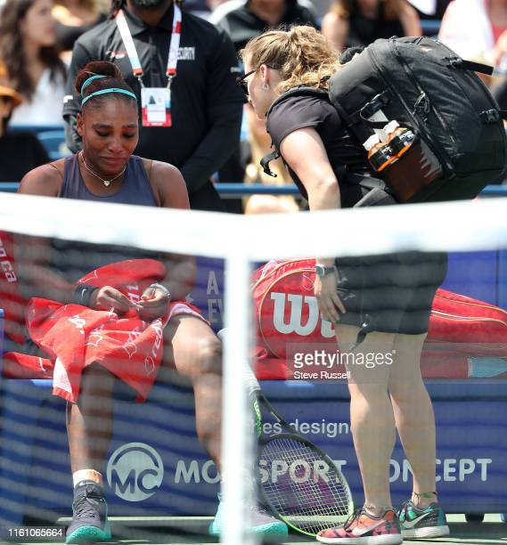 TORONTO ON AUGUST 11 Serena Williams talks to the WTA doctor as she decides to withdraw from the Rogers Cup Final Bianca Andreescu from Canada wins...