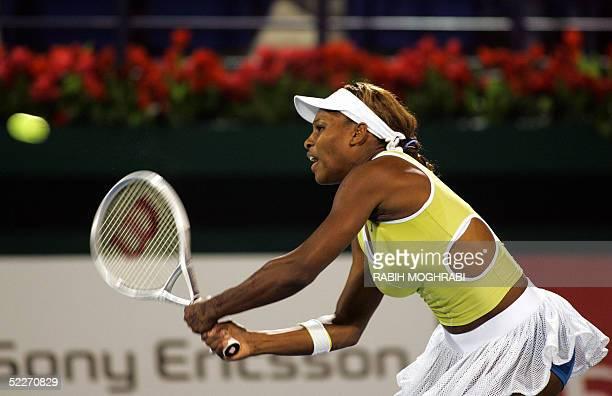 Serena Williams the former winner of all four Grand Slams returns the ball to Slovakia's Daniela Hantuchova the tour's comeback heroine during their...