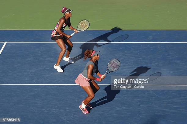 Serena Williams USA and Venus Williams USA in action in the late afternoon light on Louis Armstrong Stadium against Anastasia Pavlyuchenkova Russia...