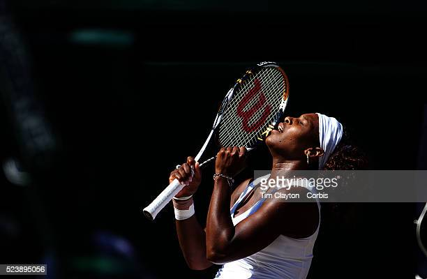 Serena Williams USA falls to her knees as she celebrates her victory over sister Venus Williams USA during the Ladies Singles Final at the All...
