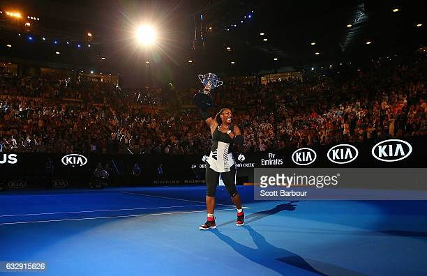 Serena Williams waves to the crowd as she leaves the court with the Daphne Akhurst Trophy after winning the Women's Singles Final against Venus...