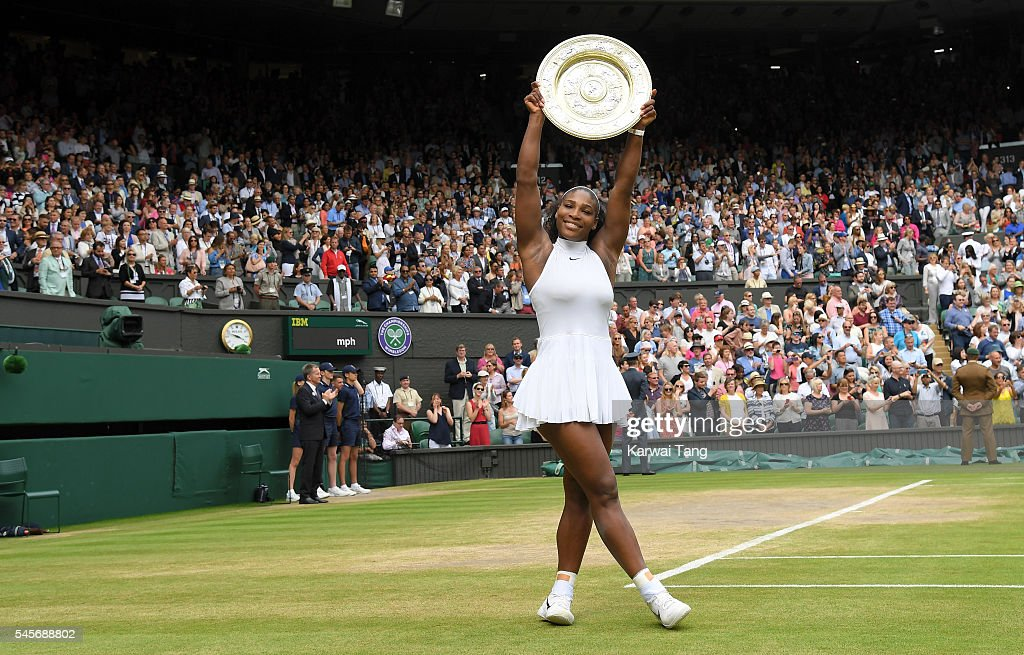 Serena Williams with the winners trophy after defeating Angelique Kerber in the women's final of the Wimbledon Tennis Championships at Wimbledon on July 09, 2016 in London, England.