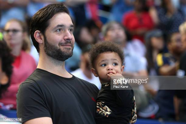 Serena Williams's husband Alexis Ohanian holds their daughter Alexis Olympia Ohanian Jr following the women's singles match between Serena Williams...