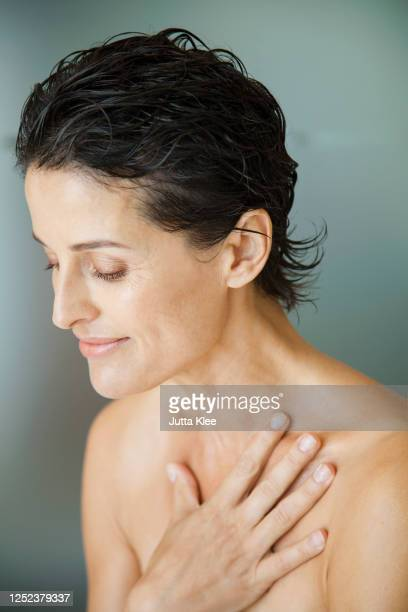 Middle Age Woman Smiling Partially Nude High-Res Stock
