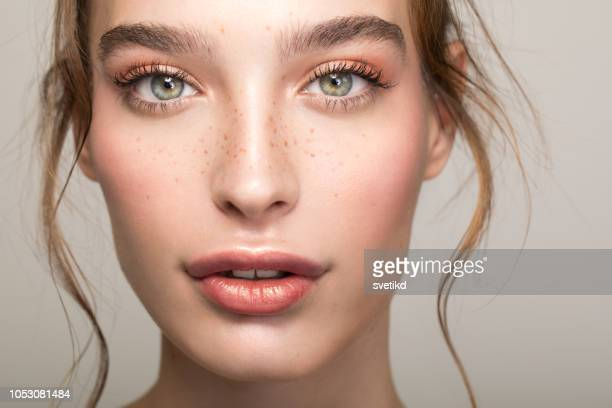 serene beauty - freckle stock photos and pictures