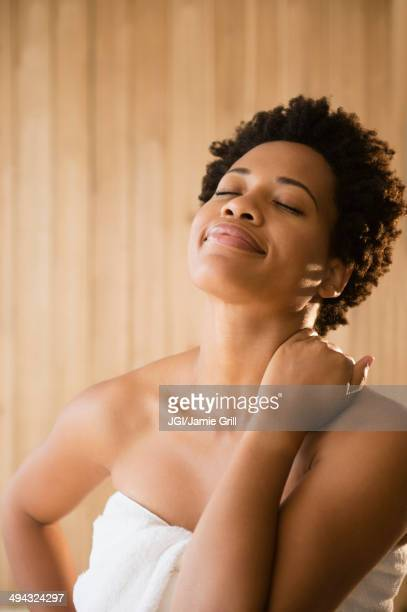 Serene Black woman wrapped in a towel