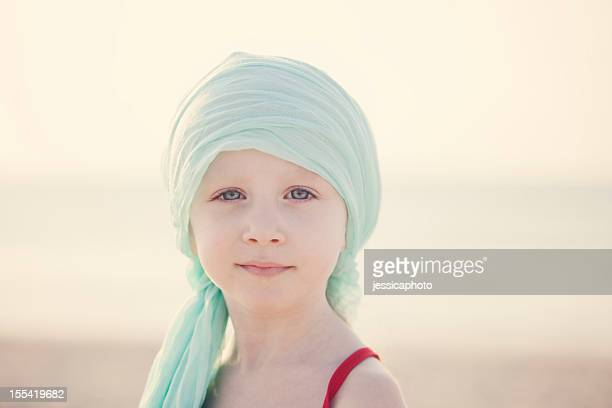 serene chemo child at beach - bald girl stock photos and pictures