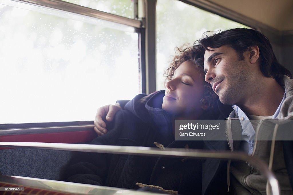 Serene couple hugging on bus : Stock Photo