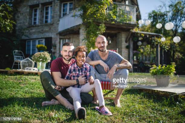 serene gay family with a adopted daughter - family with one child stock pictures, royalty-free photos & images