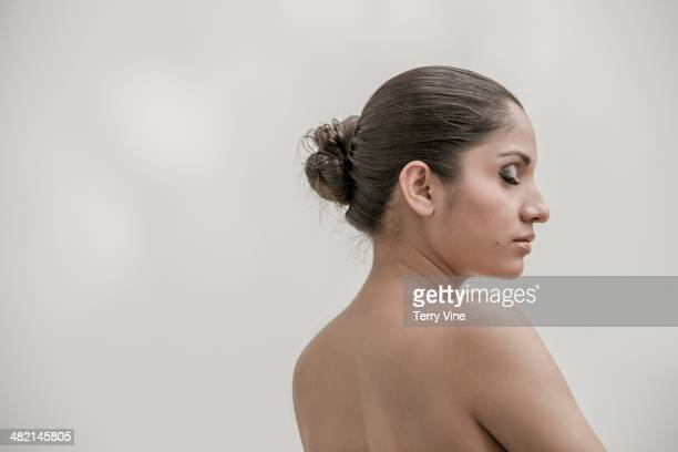 Serene Indian woman with eyes closed and bare chest