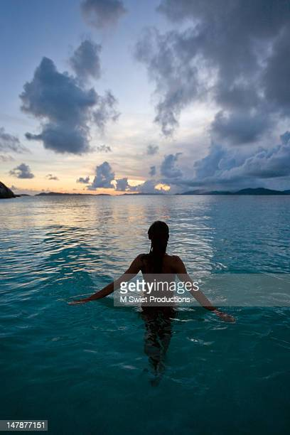 serene night swimming - waist deep in water stock pictures, royalty-free photos & images