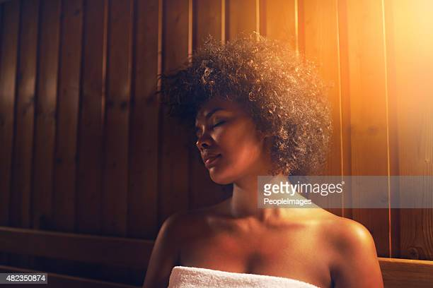 serene time in the sauna - black woman in sauna stock pictures, royalty-free photos & images