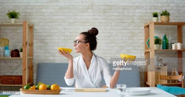 serene vegan woman with melon - aromaterapia imagens e fotografias de stock