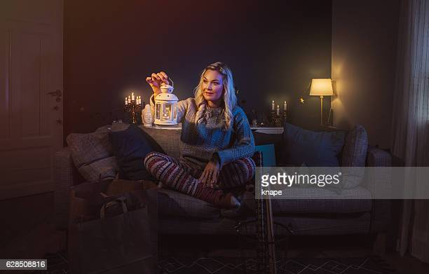 Serene woman at home with christmas gifts