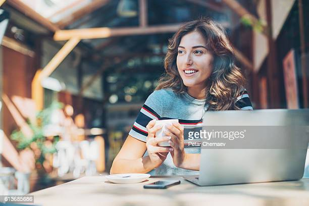 Serene woman in cafe