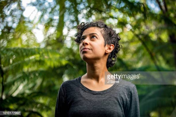 serene woman in lush outdoor setting - environmentalist stock pictures, royalty-free photos & images