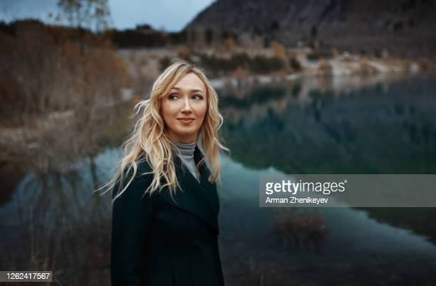 serene woman next to the lake - one mid adult woman only stock pictures, royalty-free photos & images