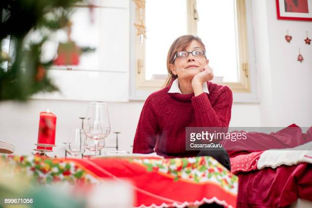 Serene Woman Relaxing During Christmas Preparation