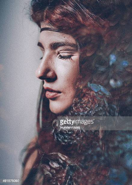Serene woman with flowers and pine cones double exposed