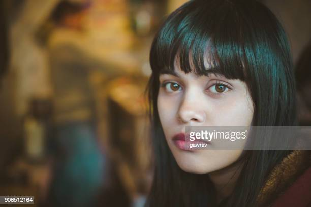 serene young woman looking at camera. - blank expression stock pictures, royalty-free photos & images