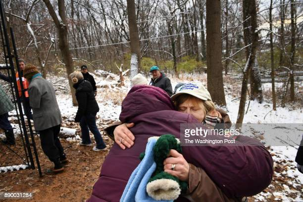 Serenella Linares center hugs Audubon Naturalist Society executive director Lisa Alexander right center after people were able to coax deer out of...