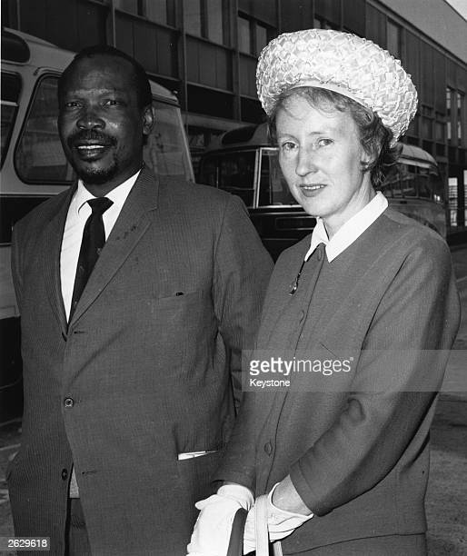 Seretese Khama of the Bechuanaland Democratic Party with his English wife Ruth at London Airport He later became the first prime minister of...