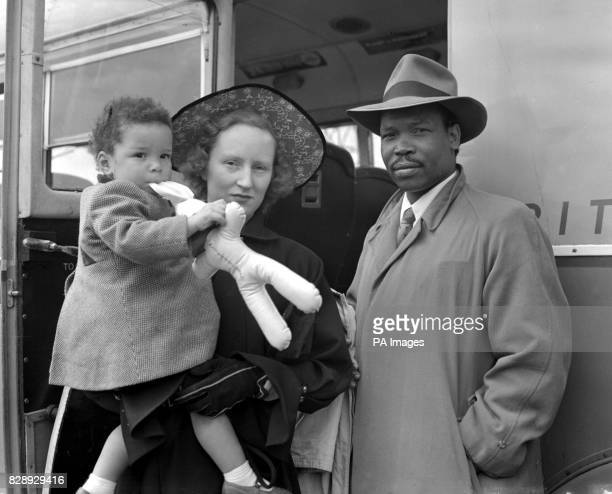 Seretse and Wife home from Jersey Seratse Khama exiled chieftain of the Bamangwato tribe his English wife Ruth and twoyear old daughter Jacqueline...