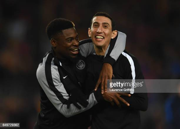 Serge Aurier and Angel Di Maria of PSG joke prior to the UEFA Champions League Round of 16 second leg match between FC Barcelona and Paris...
