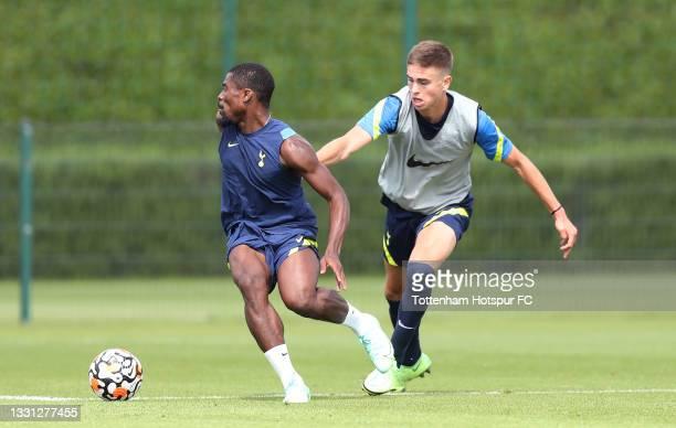Serge Aurier and Maksim Paskotsi of Tottenham Hotspur during the Tottenham Hotspur pre-season training session at Tottenham Hotspur Training Centre...