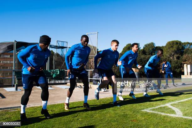 Serge Aurier Moussa Sissoko Eric Dier Mousa Dembele and Davinson Sanchez of Tottenham Hotspur do physical excercises during a training session during...