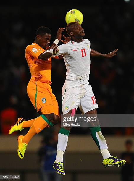 Serge Aurier of Ivory Coast challenges Dame Ndoye of Senegal during the FIFA 2014 World Cup Qualifier Playoff Second Leg between Senegal and Ivory...