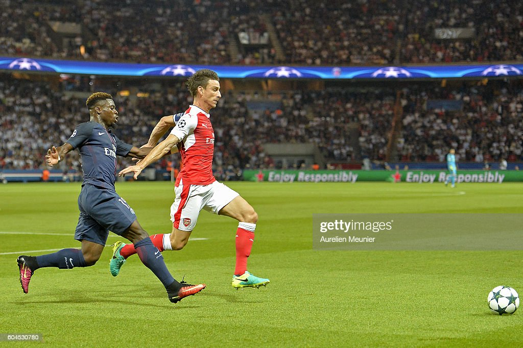 Serge Aurier of Paris Saint-Germain and Laurent Koscielny of Arsenal FC fight for the ball during the Champion's League match against Arsenal FC at Parc des Princes on September 13, 2016 in Paris, France.