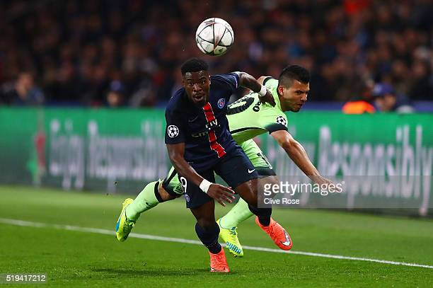Serge Aurier of Paris SaintGermain and Sergio Aguero of Manchester City compete for the ball during the UEFA Champions League Quarter Final First Leg...
