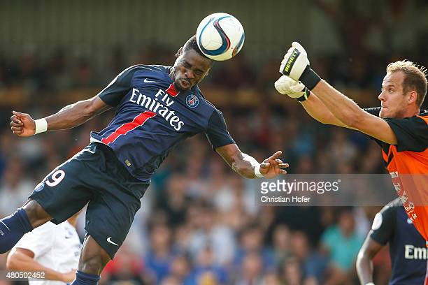 Serge Aurier of Paris SaintGermain competes for the ball in the air with Goalkeeper David Kraft of Wiener Sportklub during the Friendly Match between...