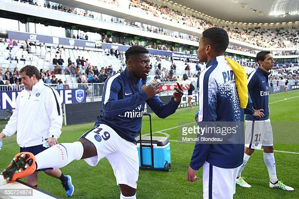 Serge Aurier of Paris SG talks to Christopher Nkunku before the French Ligue 1 match between FC Girondins de Bordeaux and Paris SaintGermain at...