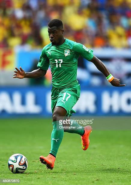 Serge Aurier of the Ivory Coast controls the ball during the 2014 FIFA World Cup Brazil Group C match between Colombia and Cote D'Ivoire at Estadio...