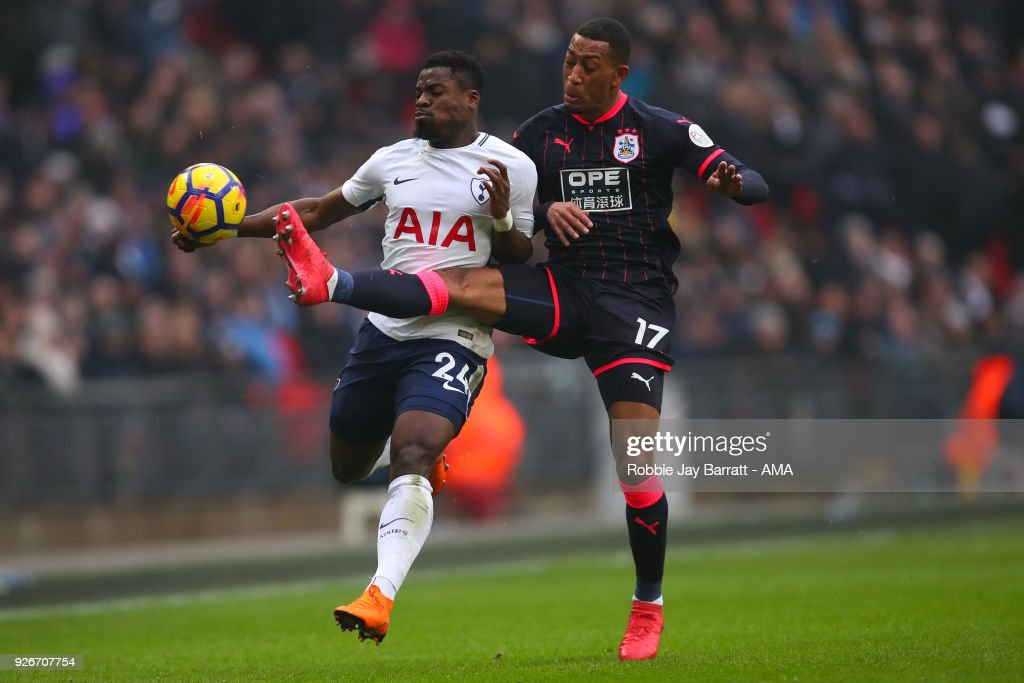 Serge Aurier of Tottenham Hotspur and Rajiv Van La Parra of Huddersfield Town during the Premier League match between Tottenham Hotspur and Huddersfield Town at Wembley Stadium on March 3, 2018 in London, England.
