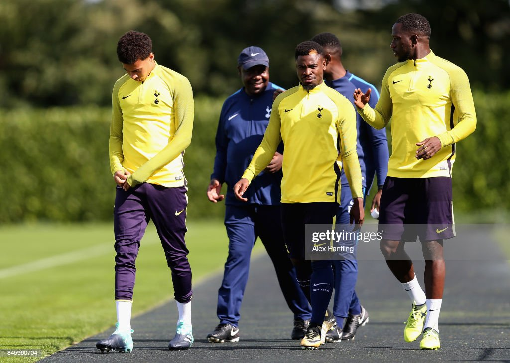 Serge Aurier of Tottenham Hotspur and team mates walk out onto the pitch during a Tottenham Hotspur training session ahead of their UEFA Champions League Group H match against Borussia Dortmund at Tottenham Hotspur Training Centre on September 12, 2017 in Enfield, England.