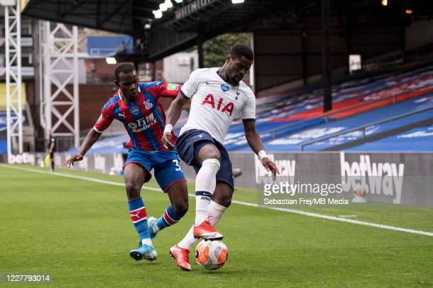 Serge Aurier of Tottenham Hotspur and Tyrick Mitchell of Crystal Palace in action during the Premier League match between Crystal Palace and...