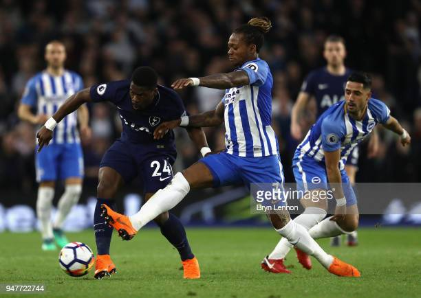 Serge Aurier of Tottenham Hotspur battles for possesion with Gaetan Bong of Brighton and Hove Albion during the Premier League match between Brighton...