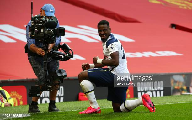 Serge Aurier of Tottenham Hotspur celebrates after scoring his sides fifth goal during the Premier League match between Manchester United and...
