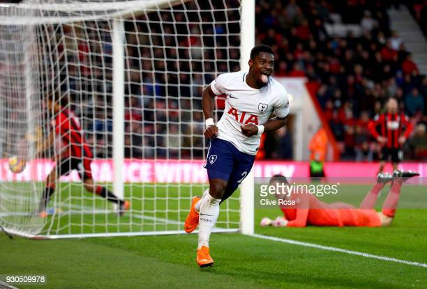 Serge Aurier of Tottenham Hotspur celebrates after scoring his sides fourth goal during the Premier League match between AFC Bournemouth and...
