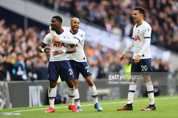 Serge Aurier of Tottenham Hotspur celebrates after scoring his team's second goal with teammates Lucas Moura and Dele Alli of Tottenham Hotspur...