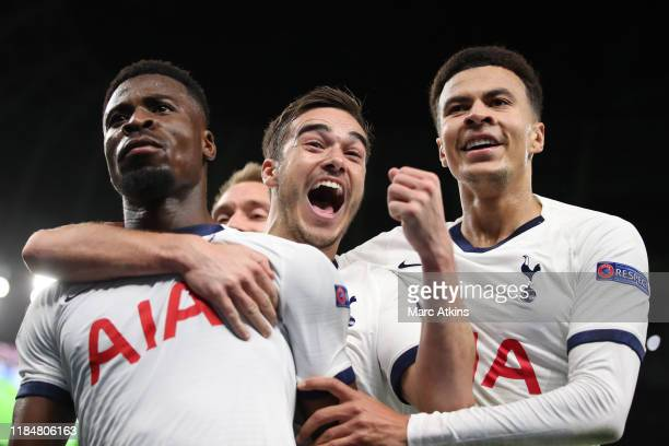 Serge Aurier of Tottenham Hotspur celebrates scoring their 3rd goal with Harry Winks and Dele Alli during the UEFA Champions League group B match...