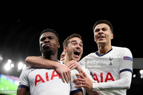 Serge Aurier of Tottenham Hotspur celebrates with Harry Winks and Dele Alli after scoring their 3rd goal during the UEFA Champions League group B...