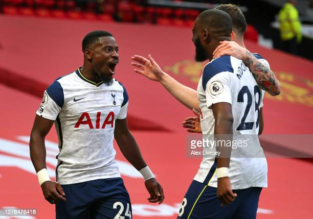 Serge Aurier of Tottenham Hotspur celebrates with teammates Tanguy Ndombele and Pierre-Emile Hojbjerg after scoring his sides fifth goal during the...